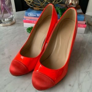 J. Crew pumps in an red/orange colour.